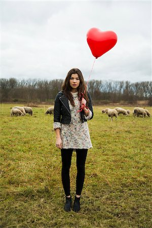 Young Woman with Heart-shaped Balloon by Sheep in Field, Mannheim, Baden-Wurttemberg, Germany Stock Photo - Rights-Managed, Code: 700-07355334