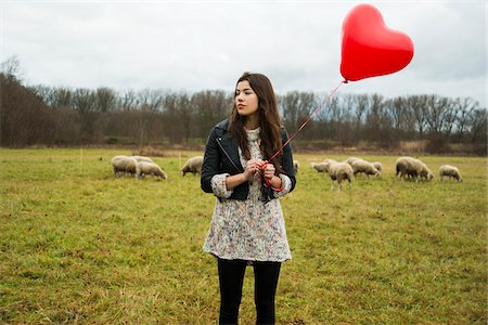 Young Woman with Heart-shaped Balloon by Sheep in Field, Mannheim, Baden-Wurttemberg, Germany Stock Photo - Rights-Managed, Code: 700-07355335