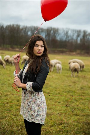 Young Woman with Heart-shaped Balloon by Sheep in Field, Mannheim, Baden-Wurttemberg, Germany Stock Photo - Rights-Managed, Code: 700-07355333