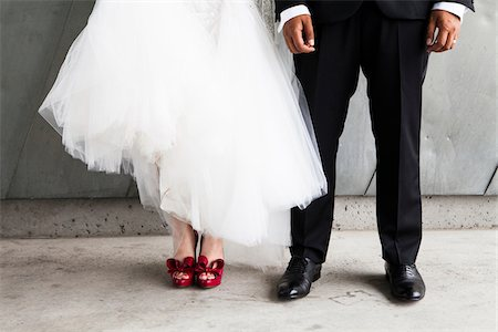 female feet close up - Waist Down Portrait of Bride and Groom, Bride wearing Red Shoes Stock Photo - Rights-Managed, Code: 700-07363836