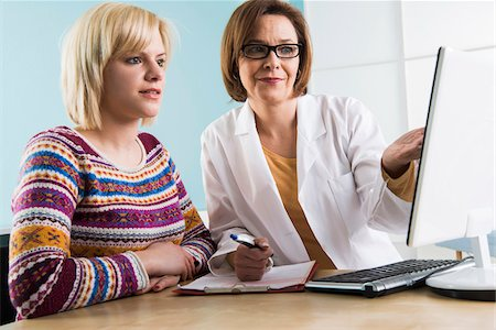 Mature Doctor with Patient in Doctor's Office Stock Photo - Rights-Managed, Code: 700-07453663