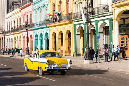 Vintage car in front of colonial architecture on the street in Havana, Cuba, UNESCO Word Heritage Site Stock Photo - Rights-Managed, Code: 700-07453778