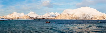 panoramic winter scene - Snow covered mountains at a fjord, pure arctic winter landscape, Noway Stock Photo - Rights-Managed, Code: 700-07453784
