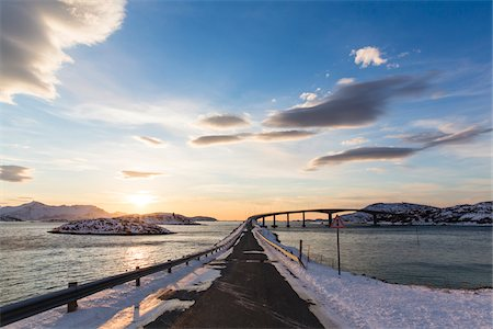 roads and sun - Bridge crossing a fjord in the arctic, winter landscape at sunset, Norway Stock Photo - Rights-Managed, Code: 700-07453787