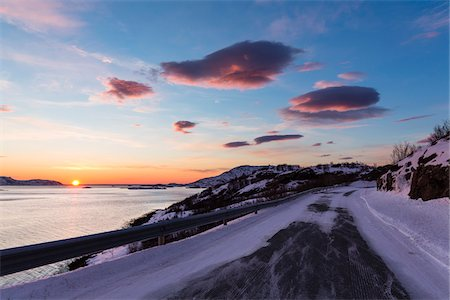 Scenic view of Icy road by a fjord at sunset, Norway Stock Photo - Rights-Managed, Code: 700-07453789