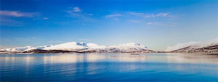 panoramic winter scene - Snow covered mountains at a fjord, pure arctic winter landscape, Norway Stock Photo - Rights-Managed, Code: 700-07453794