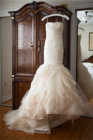 Wedding dress hanging in front of an armoire, Toronto, Ontario, Cananda Stock Photo - Rights-Managed, Code: 700-07453797