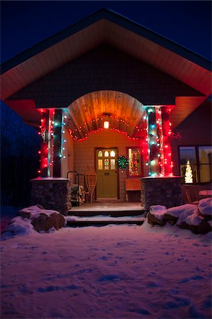 Snowy home entry with festive lights at night, Alberta, Canada. Stock Photo - Rights-Managed, Code: 700-07453819