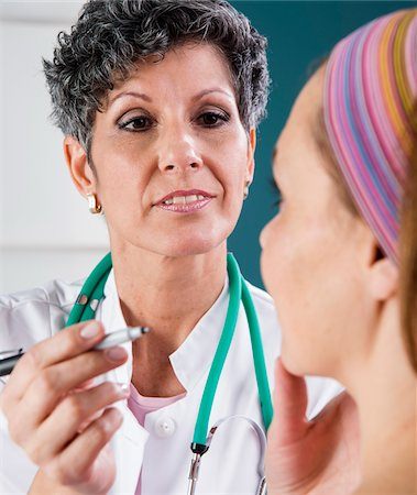 Doctor Marking Woman's Face for Treatment Stock Photo - Rights-Managed, Code: 700-07487565
