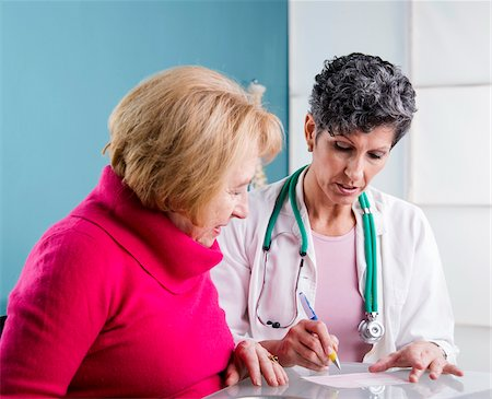 Doctor talking with Senior Patient in Doctor's Office Stock Photo - Rights-Managed, Code: 700-07487580