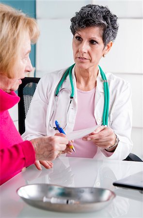 Doctor talking with Senior Patient in Doctor's Office Stock Photo - Rights-Managed, Code: 700-07487581