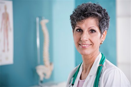 Portrait of Doctor with Stethoscope in Doctor's Office Stock Photo - Rights-Managed, Code: 700-07487615