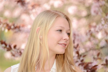 Portrait of Young Woman in front of Cherry Blossoms in Park in Spring, Franconia, Bavaria, Germany Stock Photo - Rights-Managed, Code: 700-07529025