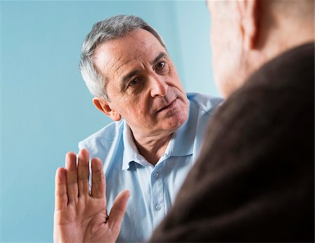 senior speaking to doctor - Senior, male doctor conferring with male patient in office, Germany Stock Photo - Rights-Managed, Code: 700-07529224