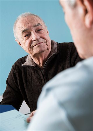 senior speaking to doctor - Senior male patient consulting doctor in office, Germany Stock Photo - Rights-Managed, Code: 700-07529226