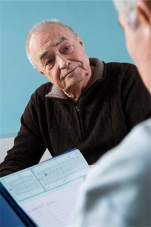 form - Senior male patient consulting doctor in office, Germany Stock Photo - Rights-Managed, Code: 700-07529227