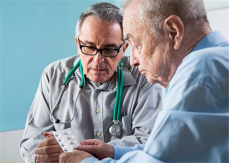 Senior, male doctor conferring with senior, male patient in office, discussing medication, Germany Stock Photo - Rights-Managed, Code: 700-07529234