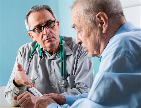Senior, male doctor conferring with senior, male patient in office, discussing medication, Germany Stock Photo - Rights-Managed, Code: 700-07529235