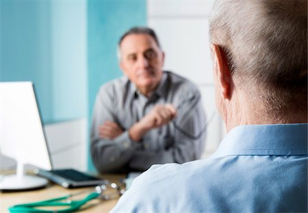 Senior, male doctor conferring with male patient in office, Germany Stock Photo - Rights-Managed, Code: 700-07529237