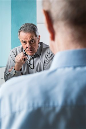 Senior, male doctor conferring with male patient in office, Germany Stock Photo - Rights-Managed, Code: 700-07529238