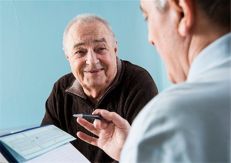 Senior male patient consulting doctor in office, Germany Stock Photo - Rights-Managed, Code: 700-07529230