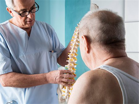 Senior, male doctor discussin spinal cord with senior, male patient, in office, Germany Stock Photo - Rights-Managed, Code: 700-07529247
