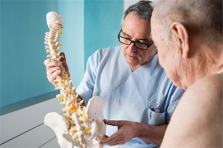 Senior, male doctor discussin spinal cord with senior, male patient, in office, Germany Stock Photo - Rights-Managed, Code: 700-07529249