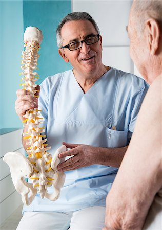 Senior, male doctor discussin spinal cord with senior, male patient, in office, Germany Stock Photo - Rights-Managed, Code: 700-07529250