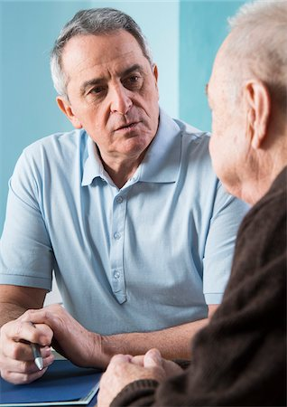 Senior, male doctor conferring with senior, male patient in office, Germany Stock Photo - Rights-Managed, Code: 700-07529264