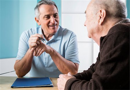 Senior, male doctor conferring with senior, male patient in office, Germany Stock Photo - Rights-Managed, Code: 700-07529265