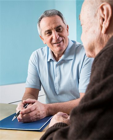 Senior, male doctor conferring with senior, male patient in office, Germany Stock Photo - Rights-Managed, Code: 700-07529266