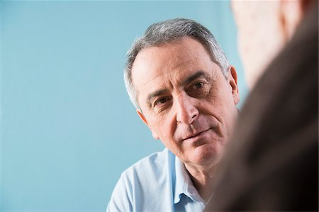 Close-up of senior, male doctor conferring with senior, male patient in office, Germany Stock Photo - Rights-Managed, Code: 700-07529267