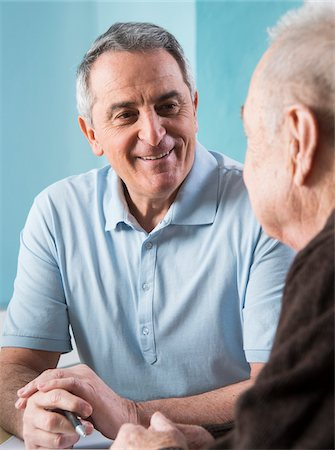 Senior, male doctor conferring with senior, male patient in office, Germany Stock Photo - Rights-Managed, Code: 700-07529263