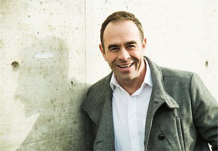 portrait smile caucasian one - Portrait of man wearing overcoat outdoors, smiling and looking at camera, Germany Stock Photo - Rights-Managed, Code: 700-07529279
