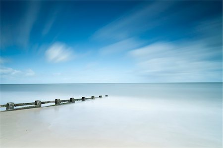Long Exposure of Tide, Beach and Clouds in Summer, Dorset, England Stock Photo - Rights-Managed, Code: 700-07541417