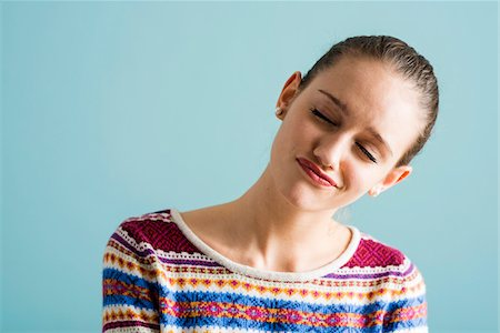 expressive - Close-up portrait of teenage girl with eyes closed, studio shot on blue background Stock Photo - Rights-Managed, Code: 700-07567448