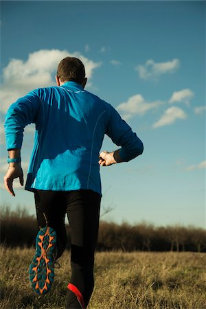 runner (male) - Back View of Mature Man Running Outdoors, Mannheim, Baden-Wurttemberg, Germany Stock Photo - Rights-Managed, Code: 700-07562396