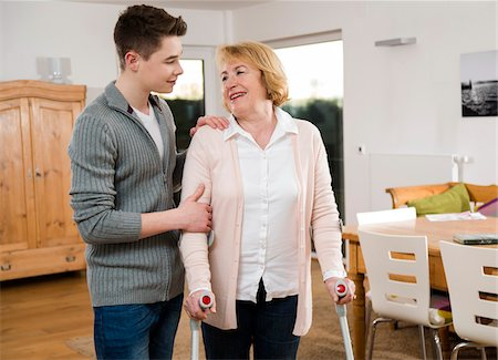 Teenage boy helping Grandmother using cruthces at home, Germany Stock Photo - Rights-Managed, Code: 700-07584806