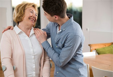 Teenage boy helping Grandmother using cruthces at home, Germany Stock Photo - Rights-Managed, Code: 700-07584808