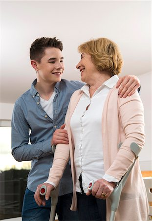 rehabilitation - Teenage boy helping Grandmother using cruthces at home, Germany Stock Photo - Rights-Managed, Code: 700-07584809