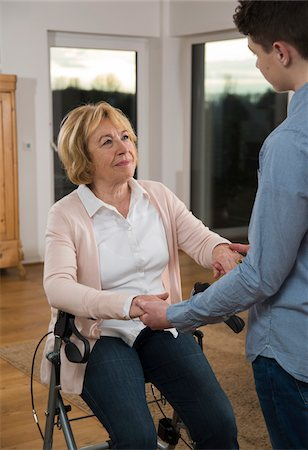 rehabilitation - Teenage boy helping Grandmother sitting in walker at home, Germany Stock Photo - Rights-Managed, Code: 700-07584814