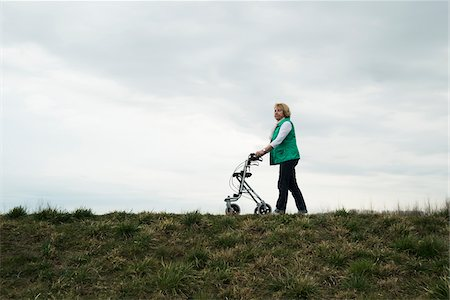 Senior woman walking along path using walker in nature, Germany Stock Photo - Rights-Managed, Code: 700-07584824
