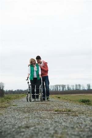 Teenage grandson with grandmother using walker on pathway in park, walking in nature, Germany Stock Photo - Rights-Managed, Code: 700-07584825