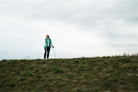 Senior woman walking along path using crutches, in nature, Germany Stock Photo - Rights-Managed, Code: 700-07584828