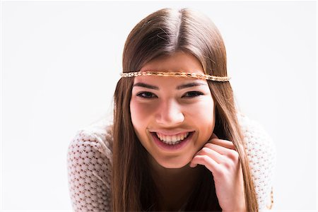 Portrait of young woman with long, brown hair, wearing headband, smiling and looking at camera, studio shot on white background Stock Photo - Rights-Managed, Code: 700-07584833