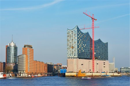Elbe Philharmonic Hall with Construction Cranes on Elbe River, HafenCity, Hamburg, Germany Fotografie stock - Rights-Managed, Codice: 700-07591283