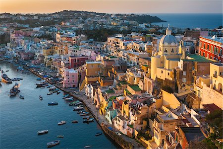 Overview of harbour at sunset, Corricella, Procida, Gulf of Naples, Campania, Italy. Stock Photo - Rights-Managed, Code: 700-07608362