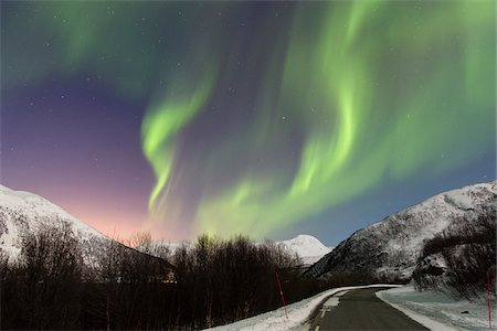 star sky night - Northern Lights (Aurora Borealis) above Road and Snow Covered Mountains in Arctic, Troms, Norway Stock Photo - Rights-Managed, Code: 700-07636918