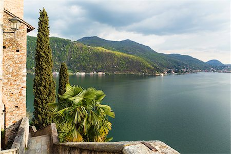 palm - Santa Maria del Sasso Church above Lago Lugano in spring, Switzerland, with view to Port Ceresio in Italy in the distance Stock Photo - Rights-Managed, Code: 700-07672082