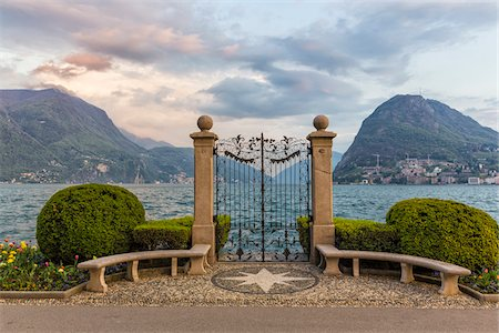 Ornamental topiary, globed shaped bushes next to wrought iron gate in Parco Civico in front of Monte San Salvatore in spring, Lugano, Switzerland Stock Photo - Rights-Managed, Code: 700-07672083